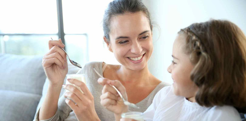 Mother-and-daughter-eating-yoghurt