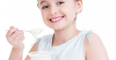 Girl eating a yogurt