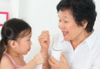 child-grandmother-eating-yogurt-1620x800