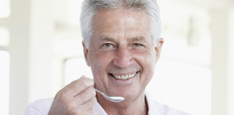 Middle Aged Man Eating Yogurt