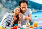 young couple eating yogurt
