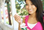 asian-woman-at-home-eating-yogurt
