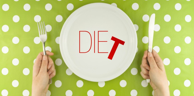 Hands-hold-flatware-above-dieting-plate