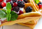 Breakfast with freshly baked belgian waffles with yogurt and berries